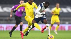 Indosport - Pemain Tottenham dalam pertandingan Liga Inggris melawan Fulham