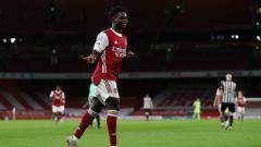 Indosport - Bukayo Saka merayakan molnya di laga Arsenal vs Newcastle United