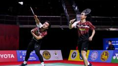 Indosport - Pasangan Mohammad Ahsan/Hendra Setiawan membongkar penyebab kekalahan mereka atas pasangan Lee Yang/Wang Chi-lin di semifinal Toyota Thailand Open 2021.