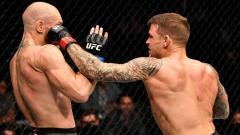 Indosport - Petarung UFC Conor McGregor mendapat pukulan keras dari Dustin Poirier dalam pertarungan UFC Fight Island di Abu Dhabi, Uni Emirat Arab.