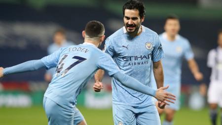Ilkay Gundogan merayakan golnya di laga West Brom vs Manchester City di Liga Inggris. - INDOSPORT