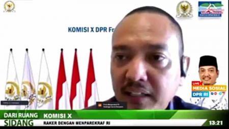 Tangkapan Layar saat Anggota Komisi X DPR RI, Yoyok Sukawi rapat kerja dengan Menteri Pariwisata dan Ekonomi Kreatif, Sandiaga Uno. - INDOSPORT