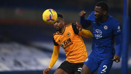 Antonio Rudiger berduel dengan Nelson Semedo di laga Chelsea vs Wolves - INDOSPORT