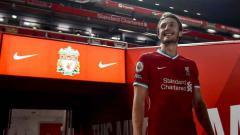 Indosport - Kedatangan Ben Davies bisa jadi ancaman bagi salah satu pemain Liverpool.