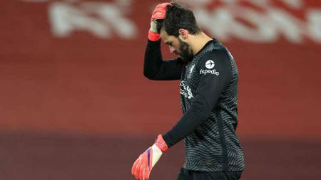 Kiper Liverpool, Alisson Becker. - INDOSPORT