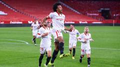 Indosport - Barcelona harus pasrah, bintang Sevilla bernama Jules Kounde selangkah lagi gabung Manchester United jelang bursa transfer lanjutan.