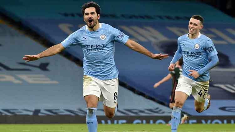 Selebrasi gol Ilkay Gundogan di laga Manchester City vs Tottenham Hotspur. Copyright: Rui Vieira/PA Images via Getty Images