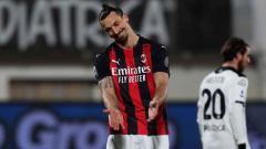 Indosport - Ekspresi kekecewaan Zlatan Ibrahimovic di laga Spezia vs AC Milan.