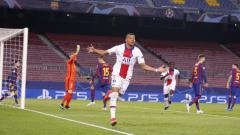 Indosport - Kylian Mbappe saat merayakan gol penyama kedudukan dalam pertandingan Barcelona vs PSG