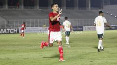 Indosport - M Rafli berselebrasi usai mencetak gol kedua Timnas Indonesia U-23 ke gawang Tira Persikabo.