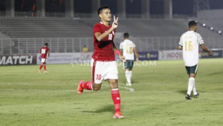 M Rafli berselebrasi usai mencetak gol kedua Timnas U-23. (Foto: Herry Ibrahim/INDOSPORT).