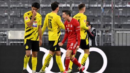 Robert Lewandowski selebrasi usai cetak gol lawan Borussia Dortmund. - INDOSPORT