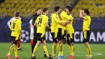 Selebrasi pemain Borussia Dortmund setelah mencetak gol ke gawang Sevilla. - INDOSPORT
