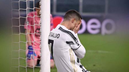 Reaksi Cristiano Ronaldo, pemain Juventus tersingkir dari Liga Champion usai kalah dari Porto. - INDOSPORT