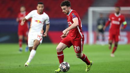 Terselip empat catatan spesial Liverpool usai sanggup menyingkirkan RB Leipzig dari babak 16 besar Liga Champions 2020-2021. - INDOSPORT