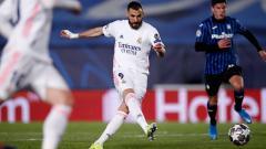 Indosport - Karim Benzema mencetak gol di laga Liga Champions Real Madrid vs Atalanta