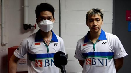 Media China menyoroti kemenangan perdana pasangan ganda putra Indonesia yakni Kevin Sanjaya/Marcus Gideon di kompetisi All England 2021. - INDOSPORT