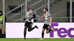 Indosport - Selebras Paul Pogba saat merayakan golnya di laga AC Milan vs Manchester United di Liga Europa