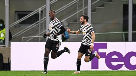 Selebras Paul Pogba saat merayakan golnya di laga AC Milan vs Manchester United di Liga Europa - INDOSPORT