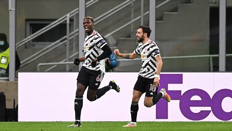 Selebras Paul Pogba saat merayakan golnya di laga AC Milan vs Manchester United di Liga Europa Copyright: Twitter @EuropaLeague
