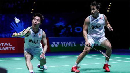 Pasangan ganda putera Indonesia, Kevin Sanjaya Sukamuljo/Marcus Fernaldi Gideon saat bertanding di Yonex All England 2021. - INDOSPORT