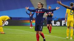 Indosport - Selebrasi Antoine Griezmann saat membela Timnas Prancis