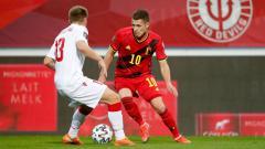 Indosport - Pemain Timnas Belgia, Thorgan Hazard, tengah membawa bola dalam laga Kualifikasi Piala Dunia 2022 antara Belgia vs Belarusia.