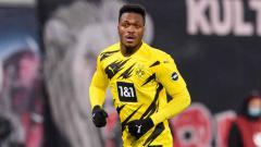 Indosport - AC Milan dikabarkan selangkah lagi bakal resmi mendapatkan Dan-Axel Zagadou, bek tangguh kepunyaan Borussia Dortmund.