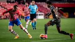 Indosport - Pertandingan Granada vs Manchester United di Liga Europa 20/21