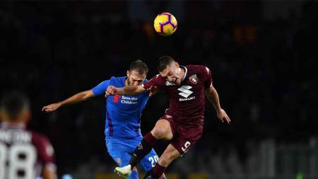 Kupas tuntas adu kualitas Andrea Belotti vs Dusan Vlahovic, dua bomber top Liga Italia yang jadi buruan AC Milan di bursa transfer musim panas. - INDOSPORT