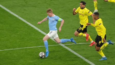 Berikut 4 rekor yang tercipta usai Manchester City bekuk Dortmund 2-1 di leg kedua 8 besar Liga Champions, termasuk Pep Guardiola yang samai Jose Mourinho. - INDOSPORT