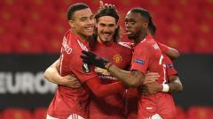 Indosport - Selebrasi Edinson Cavani usai mencetak gol ke gawang Granada.