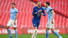 Indosport - Selebrasi Hakim Ziyech usai membobol gawang Man City