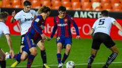 Indosport - Berikut hasil dan jalannya pertandingan pekan ke-34 LaLiga Spanyol 2020/21 antara Valencia vs Barcelona, Senin (03/05/21) pukul 02.00 WIB di Mestala stadium.