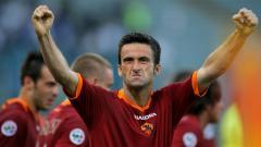 Indosport - Potret kemenangan telak AS Roma atas Inter Milan dalam pertandingan final Coppa Italia, 9 Mei 2007.