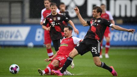 Bayern Munchen harus tertahan di markas Freiburg pada pertandingan pekan ke-33 Bundesliga Jerman, Sabtu (15/05/21). - INDOSPORT