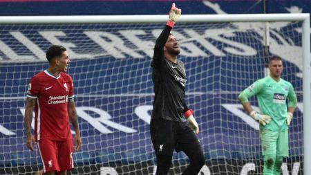 Selebrasi gol Alisson Becker di laga West Brom vs Liverpool. - INDOSPORT