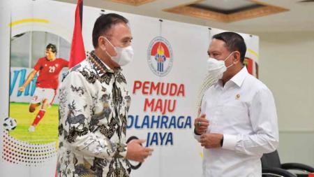 Ketua Umum PSSI melakukan rapat koordinasi dengan Menteri Pemuda dan Olahraga (Menpora) Zainudin Amali pada Senin (24/5) di kantor Kemenpora, Jakarta. Pertemuan ini membahas persiapan dan izin kompetisi Liga 1 dan 2 2021-2022. - INDOSPORT