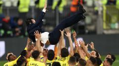 Indosport - Unai Emery mendapat apresiasi dari pemain Villarreal pasca menjuarai Liga Europa 2020/21.