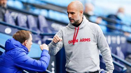 Pelatih Chelsea Thomas Tuchel dan pelatih Manchester City Pep Guardiola. - INDOSPORT