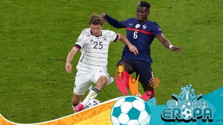 Thomas Muller (kiri) dan Paul Pogba berduel dalam laga penyisihan Grup F Euro 2020 antara Prancis vs Jerman, Rabu (16/06/21) dini hari WIB. - INDOSPORT