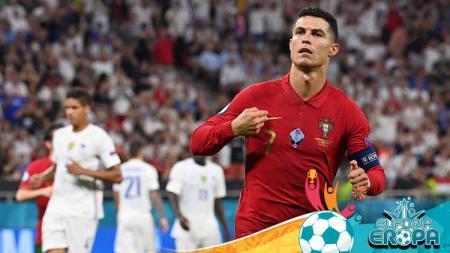Selebrasi pemain Portugal, Cristiano Ronaldo usai cetak gol penalti ke gawang Prancis di Euro 2020. - INDOSPORT