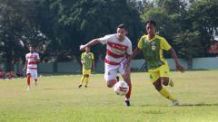 Indosport - Madura United dalam uji coba kontra PON Jatim.