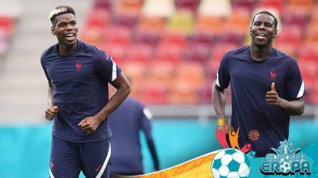 Pemain Prancis, Paul Pogba dan Kurt Zouma saat melakukan pemanasan sesi latihan di UEFA Euro 2020. - INDOSPORT