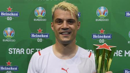 Granit Xhaka terpilih sebagai Pemain Terbaik (MoTM) di laga Swiss vs Prancis. - INDOSPORT