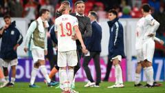 Indosport - Luis Enrique menenangkan para anak asuhnya di Spanyol