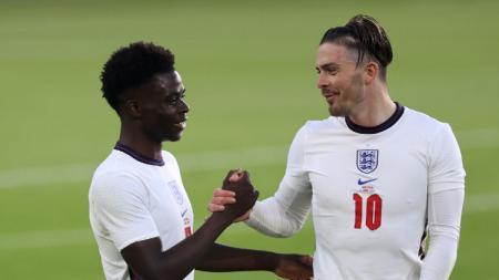 Penyerang sayap Timnas Inggris, Jack Grealish, meradang setelah dianggap ogah ambil penalti dalam laga final Euro 2020 melawan Italia, Senin (12/07/21). - INDOSPORT