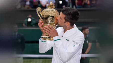 Novak Djokovic menjadi juara tenis di Wimbledon 2021. - INDOSPORT