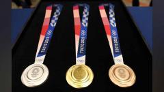 Indosport - Medali Olimpiade Tokyo 2020.