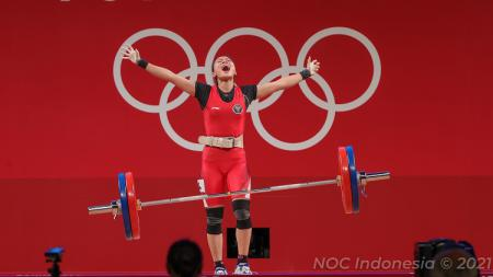 Windy Cantika sukses merebut medali perunggu di Olimpiade Tokyo. Rupanya, sang ibu Siti Aisah juga lifter kelas atas yang pernah meraih medali di kejuaraan dunia. - INDOSPORT